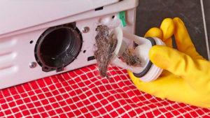 не сливается вода в стиральной машине в конце стирки