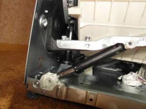 Специальные амортизаторы для стиральной машины: 2 их вида